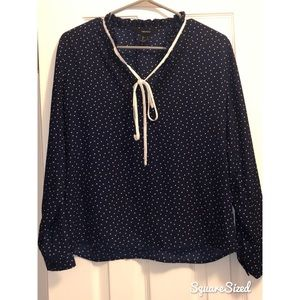 Navy blue and white long sleeve polka dot top